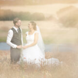 Romantic look with wedding couple in the field
